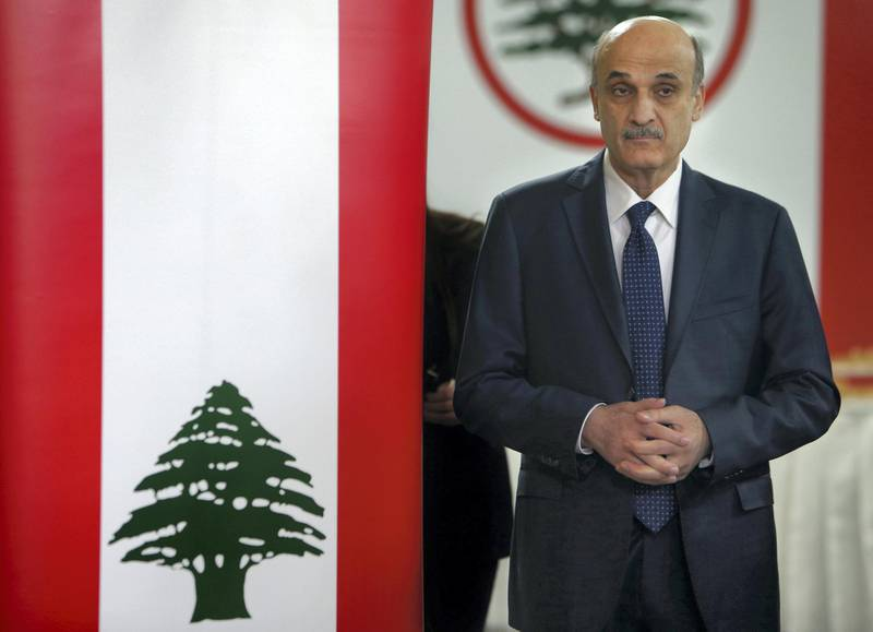 Samir Geagea, leader of the Christian Lebanese Forces party, enters a hall to meet with his senior party officials to announce his candidacy for the Lebanese presidency, in Maarab east Beirut, Lebanon, Friday April 4, 2014. The former Lebanese warlord who now leads a Christian right-wing party has announced he will run for president in the tiny Arab country's elections later this spring. According to Lebanon's power-sharing system, the president must be a Maronite Christian, the prime minister a Sunni Muslim and the parliament speaker a Shiite Muslim. (AP Photo/Hussein Malla)