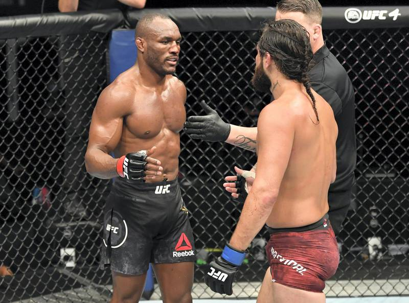 ABU DHABI, UNITED ARAB EMIRATES - JULY 12: (L-R) Kamaru Usman of Nigeria and Jorge Masvidal talk after the conclusion of their UFC welterweight championship fight during the UFC 251 event at Flash Forum on UFC Fight Island on July 12, 2020 on Yas Island, Abu Dhabi, United Arab Emirates. (Photo by Jeff Bottari/Zuffa LLC)