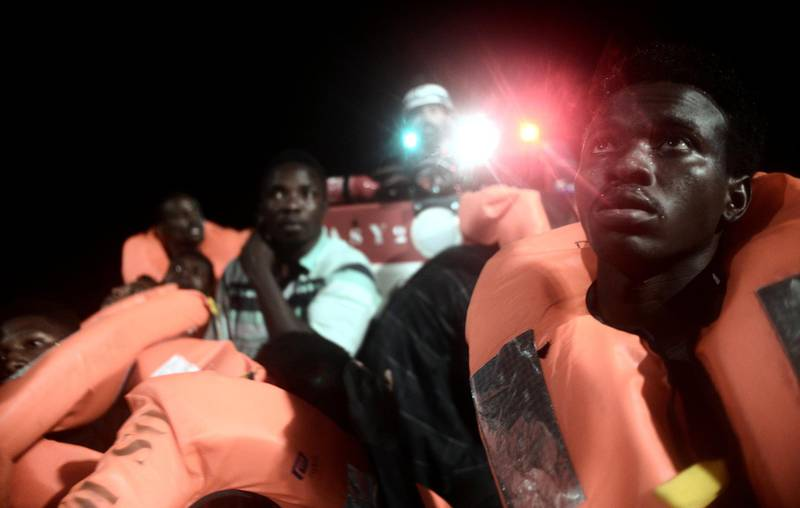Migrants are rescued by staff members of the MV Aquarius, a search and rescue ship run in partnership between SOS Mediterranee and Medecins Sans Frontieres in the central Mediterranean Sea, June 9, 2018. Picture taken June 9, 2018. Karpov/handout via REUTERS ATTENTION EDITORS - THIS IMAGE WAS PROVIDED BY A THIRD PARTY. NO RESALES. NO ARCHIVES.