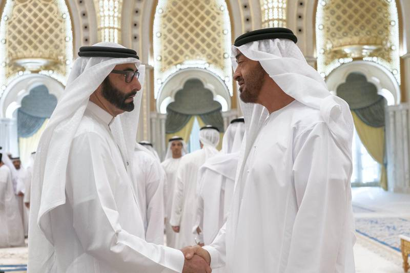 ABU DHABI, UNITED ARAB EMIRATES - May 08, 2019: HH Sheikh Mohamed bin Zayed Al Nahyan, Crown Prince of Abu Dhabi and Deputy Supreme Commander of the UAE Armed Forces (R), greets HE Mohamed Ahmad Al Bowardi, UAE Minister of State for Defence Affairs (L), during an iftar reception at Qasr Al Watan.  ( Rashed Al Mansoori / Ministry of Presidential Affairs ) ---