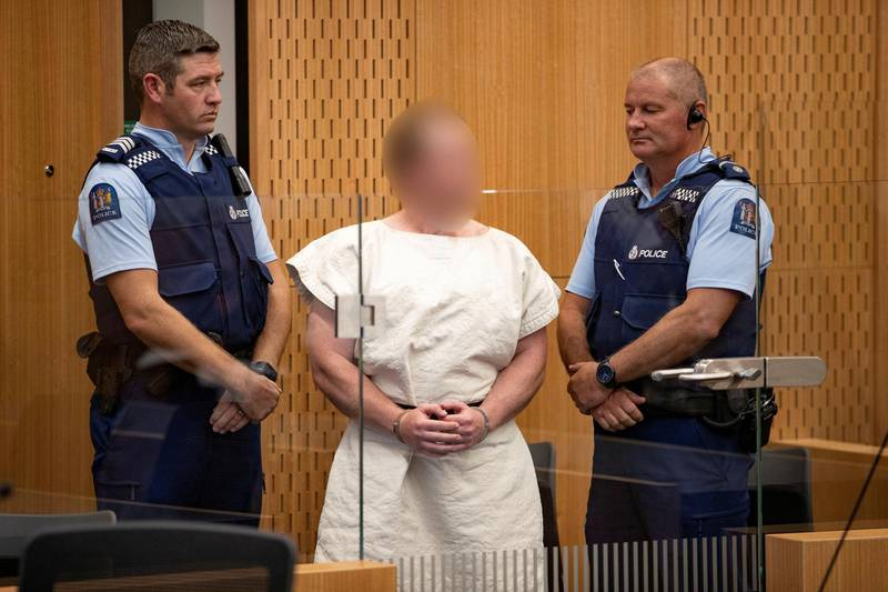 FILE PHOTO - Brenton Tarrant, charged for murder in relation to the mosque attacks, is seen in the dock during his appearance in the Christchurch District Court, New Zealand March 16, 2019.   Mark Mitchell/New Zealand Herald/Pool via REUTERS/File Photo   ATTENTION EDITORS - PICTURE PIXELATED AT SOURCE. SUSPECT FACE MUST BE PIXELATED. ONLY HIS FACE.
