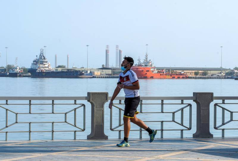 Abu Dhabi, United Arab Emirates, June 14, 2020.     Abu Dhabi residents exercise on the reopened side of the Corniche as the UAE gradually returns to normal life as restrictions are being eased. Victor Besa  / The NationalSection:  NAReporter:
