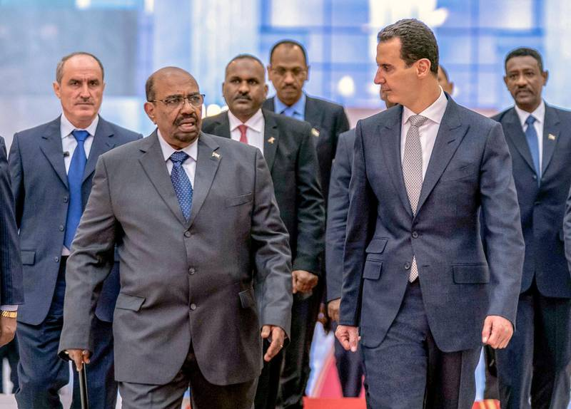 epa07236364 A handout photo made available by Syrian Arab news agency SANA show Syrian  President Bashar al-Assad (R) receive the President of Sudan Omar Hassan al-Bashir (L) at Damascus international airport in Damascus, Syria, 16 December 2018. President of Sudan Omar Hassan al-Bashir arrived on Sunday afternoon at Damascus International Airport for an official visit. Afterwards, President al-Assad and President al-Bashir headed to the People's Palace, where they held a session of talks on bilateral relations and developments in Syria and the region.  EPA/SANA HANDOUT  HANDOUT EDITORIAL USE ONLY/NO SALES