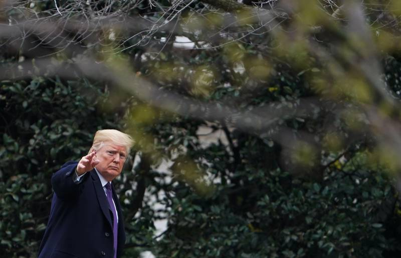 TOPSHOT - US President Donald Trump walks to the Oval Office upon return to the White House after addressing the Latino Coalition Legislative Summit at a hotel in Washington, DC on March 7, 2018. / AFP PHOTO / MANDEL NGAN