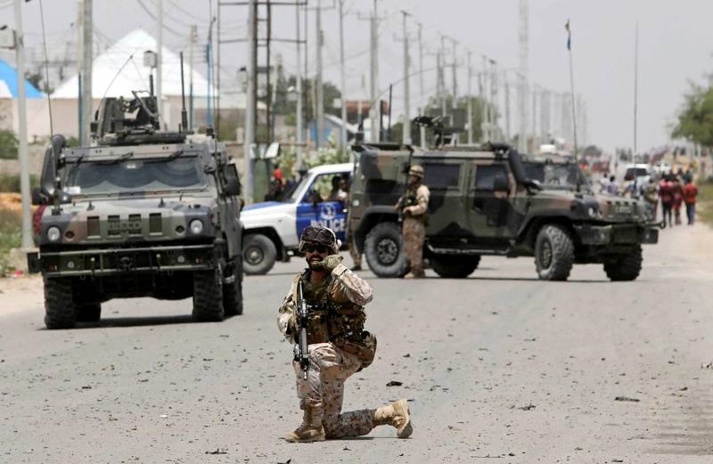 FILE PHOTO: A soldier holds a position as damage is assessed after Islamist group al Shabaab hit a European Union armoured convoy in Mogadishu, Somalia October 1, 2018. REUTERS/Feisal Omar/File Photo