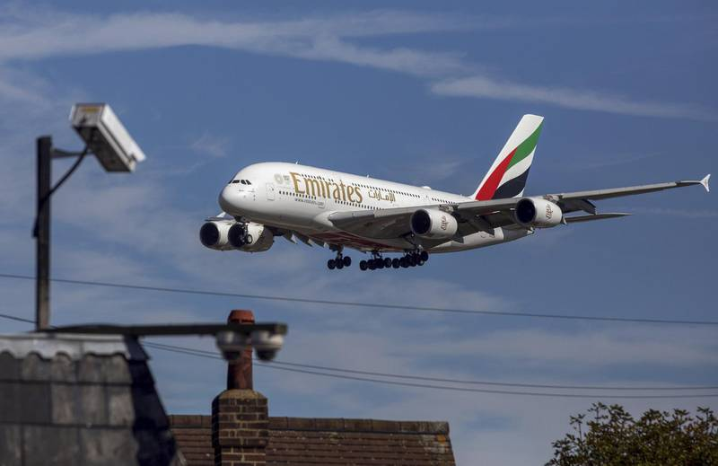 An Airbus SE A380 passenger aircraft, operated by Emirates Airline, passes a CCTV camera as it prepares to land at London Heathrow Airport in London, U.K., on Friday, Sept. 13, 2019. Climate activists were planning to fly toy drones near Heathrow Friday as part of a campaign to draw attention to an expected increase in greenhouse gas emissions from a planned expansion of the airport. Photographer: Chris Ratcliffe/Bloomberg