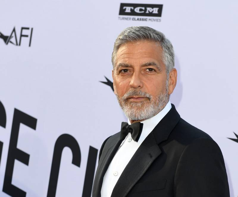 (FILES) In this file photo taken on June 07, 2018 US actor George Clooney attends the 46th American Film Institute Life Achievement Award Gala at the Dolby Theatre in Hollywood. YouTube Premium webcast has commissioned a dark humor comedy that will be co-produced by George Clooney and Kirsten Dunst, who will also be the lead performer, according to the specialized media on June 25, 2018 / AFP / VALERIE MACON