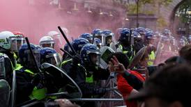 Far-right protesters clash with police after statues boarded up in London