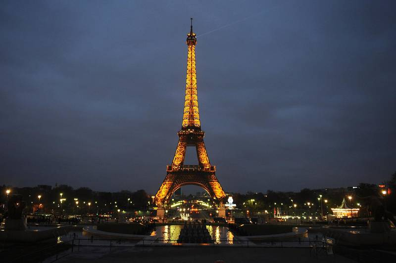 PARIS, FRANCE - MARCH 31:  The Eiffel Tower is seen before the lights are switched off for Earth Hour 2012, on March 31, 2012 in Paris, France. According to organisers the biggest ever Earth Hour has participants including individuals, companies and landmarks in 147 countries and over 5,000 cities, agreeing to switch off their lights for one hour at 8:30pm. The Brandenburg Gate in Berlin, the Eiffel Tower in Paris, Big Ben Clock Tower in London, the Christ the Redeemer statue in Rio de Janeiro and the Empire State Building in New York are among the monuments whose operators have agreed to participate in the demonstration.  (Photo by Antoine Antoniol/Getty Images)