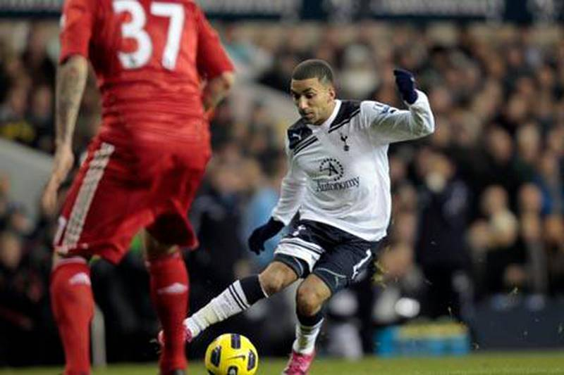 Tottenham Hotspur's Aaron Lennon, controis the bal in front of Liverpool's Martin Skrtel, during their English Premier League soccer match at the White Hart Lane ground in London, Sunday, Nov. 28, 2010.  Tottenham won the match 2-1. (AP Photo/Lefteris Pitarakis)  NO INTERNET/MOBILE USAGE WITHOUT FOOTBALL ASSOCIATION PREMIER LEAGUE (FAPL) LICENCE - CALL +44 (0)20 7864 9121 or EMAIL info@football-dataco.com FOR DETAILS