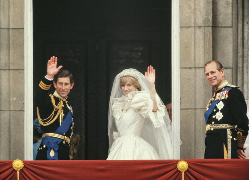 LONDON, UNITED KINGDOM - JULY 29:  Prince Charles And Princess Diana Waving From  The Balcony Of Buckingham Palace.  They Are Accompanied By Prince Philip.  The Princess Is Wearing A Dress Designed By David And Elizabeth Emanuel.  (Photo by Tim Graham Photo Library via Getty Images)
