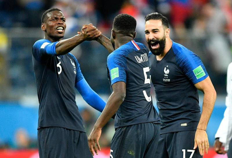 France's Paul Pogba, left, celebrates with Samuel Umtiti and Adil Rami after their team advanced to the final during the semifinal match between France and Belgium at the 2018 soccer World Cup in the St. Petersburg Stadium in St. Petersburg, Russia, Tuesday, July 10, 2018. (AP Photo/Martin Meissner)