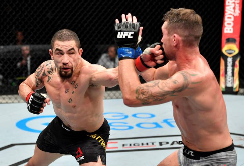 ABU DHABI, UNITED ARAB EMIRATES - JULY 26: (L-R) Robert Whittaker of New Zealand punches Darren Till of England in their middleweight fight during the UFC Fight Night event inside Flash Forum on UFC Fight Island on July 26, 2020 in Yas Island, Abu Dhabi, United Arab Emirates. (Photo by Jeff Bottari/Zuffa LLC via Getty Images)