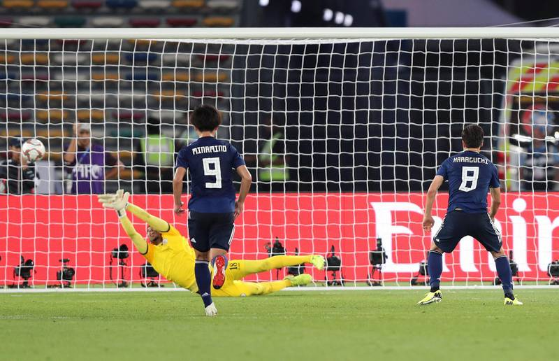 Abu Dhabi, United Arab Emirates - January 13, 2019: Haraguchi Genki of Japan scores a penalty during the game between Japan and Oman in the Asian Cup 2019. Sunday, January 13th, 2019 at Zayed Sports City Stadium, Abu Dhabi. Chris Whiteoak/The National
