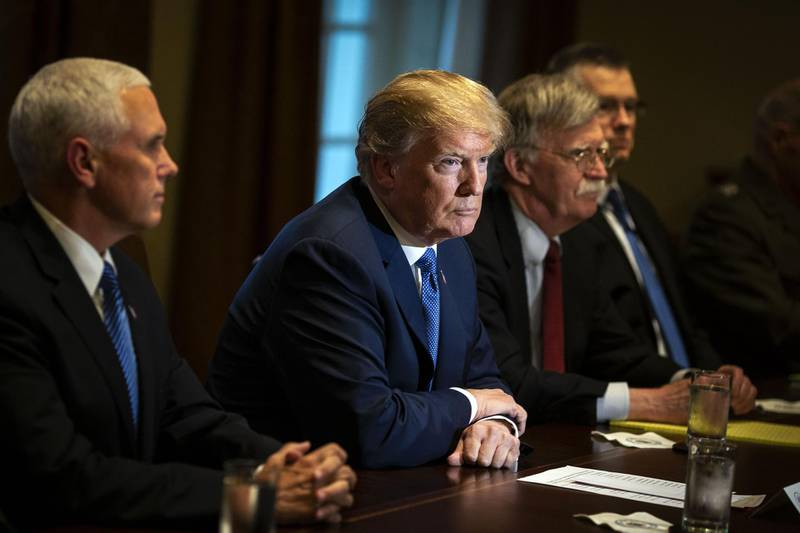 U.S. President Donald Trump, center, listens during a meeting with senior military leadership in the Cabinet Room of the White House in Washington, D.C., U.S., on Monday, April 9, 2018. Trump said he'll decide within two days on U.S. retaliation against Syria for a suspected chemical weapons attack by President Bashar al-Assad's regime over the weekend, and suggested Russian President Vladimir Putin may share responsibility. Photographer: Al Drago/Bloomberg