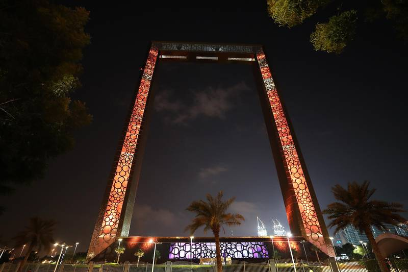 DUBAI, UNITED ARAB EMIRATES , November 18 – 2020 :- Dubai Frame light up in the colors of Omani flag to celebrate the 50th National Day in Dubai. (Pawan Singh / The National) For News/Standalone/Big Picture/Online/Instagram