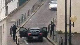 Gunmen kill editor, cartoonists in attack on Paris magazine
