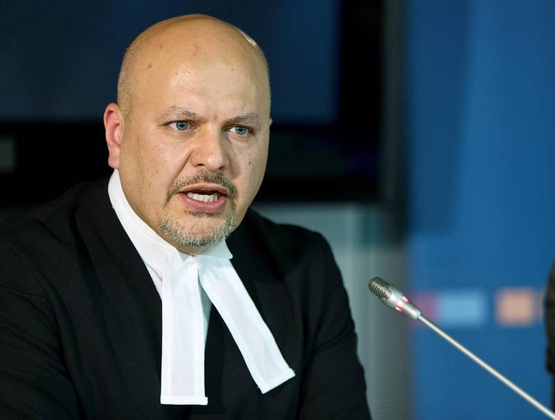 FILE PHOTO: Defence Counsel for Kenya's Deputy President William Ruto, Karim Khan attends a news conference before the trial of Ruto and Joshua arap Sang at the International Criminal Court (ICC) in The Hague September 9, 2013. REUTERS/Michael Kooren (NETHERLANDS - Tags: POLITICS CRIME LAW)/File Photo