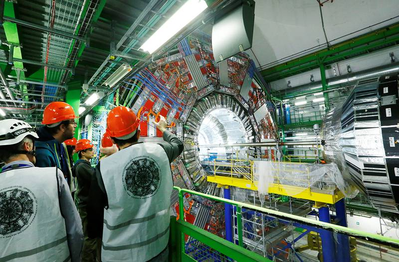 A group of visitors is pictured at the Compact Muon Solenoid (CMS) particle detector at The European Organization for Nuclear Research (CERN) in Cessy, France, March 3, 2017. REUTERS/Denis Balibouse
