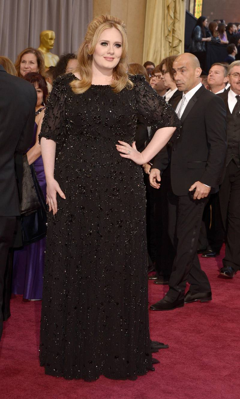 epa03599295 British singer Adele arrives on the red carpet for the 85th Academy Awards at the Dolby Theatre in Hollywood, California, USA, 24 February 2013. The Oscars are presented for outstanding individual or collective efforts in up to 24 categories in filmmaking.  EPA/PAUL BUCK