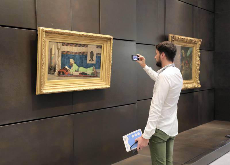 Abu Dhabi, United Arab Emirates - November 6th, 2017: Piece: Young Emir studying at the Louvre. Louvre Media Day. Monday, November 6th, 2017 at Louvre, Abu Dhabi. Chris Whiteoak / The National