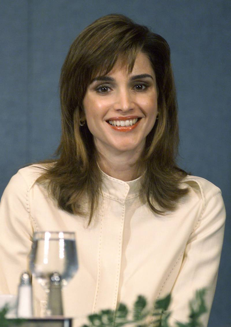 387758 01: Her Majesty Queen Rania of Jordan listens to her husband , Jordan's King Abdullah speak at the National Press Club, April 11, 2001 in Washington DC. (Photo by Mark Wilson/Newsmakers)