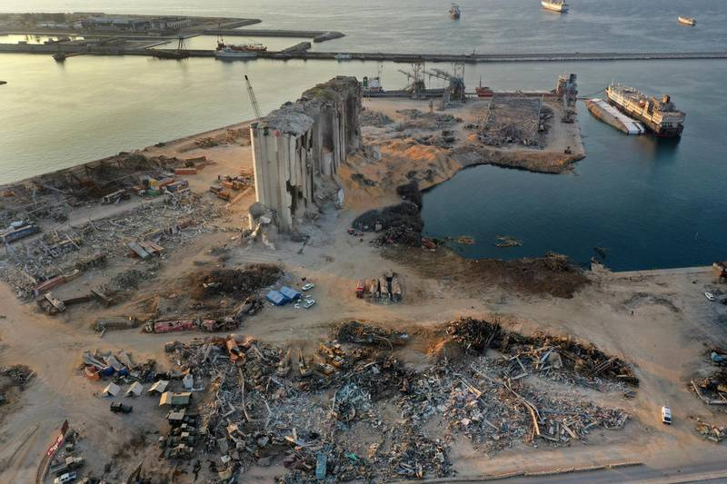 This Aug. 29, 2020 photo shows rubble and debris around the silo that was destroyed by Aug. 4 explosion that hit the seaport of Beirut, Lebanon. The Lebanese military discovered more than 4 tons of ammonium nitrate near Beirut's port on Thursday, Sept. 3, a find that's a chilling reminder of the horrific explosion. (AP Photo/Hussein Malla)