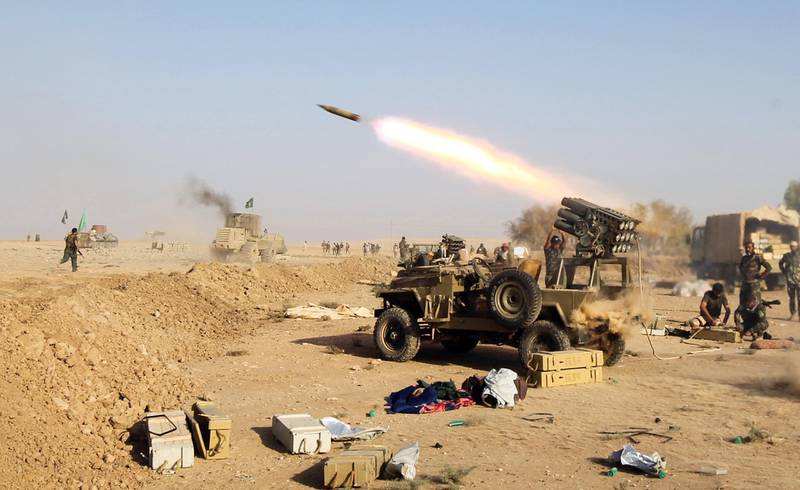 Shiite fighters from the Hashed al-Shaabi (Popular Mobilisation) launches missiles on the village of Salmani, south of Mosul, on October 30, 2016 during the ongoing battle against Islamic State group jihadists to liberate the city of Mosul. - Iraqi paramilitary forces said they had captured several villages southwest of Mosul from the Islamic State group on Sunday, the second day of an operation to cut the jihadists' supply lines. (Photo by AHMAD AL-RUBAYE / AFP)