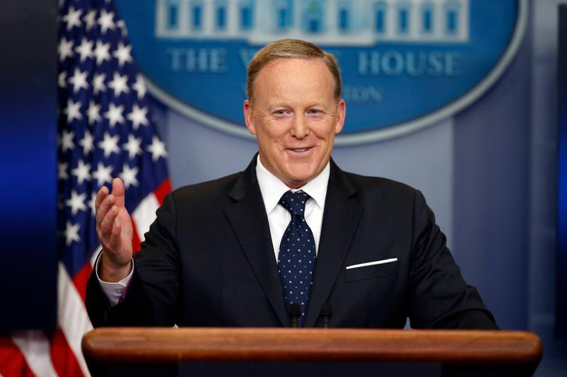 FILE - In this Tuesday, June 20, 2017, file photo, then-White House press secretary Sean Spicer smiles as he answers a question during a briefing at the White House,  in Washington. Former White House press secretary Spicer is working on a television interview show in which he banters with guests about a variety of topics. (AP Photo/Alex Brandon, File)