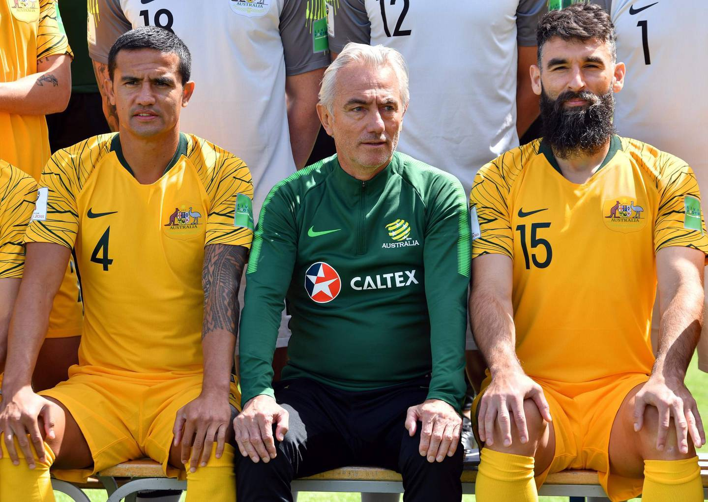 Australia's forward Tim Cahill (L), coach Bert van Marwijk and midfielder Mile Jedinak (R) pose on the sideline of a training session in Kazan on June 12, 2018, ahead of the Russia 2018 World Cup football tournament.  / AFP / SAEED KHAN