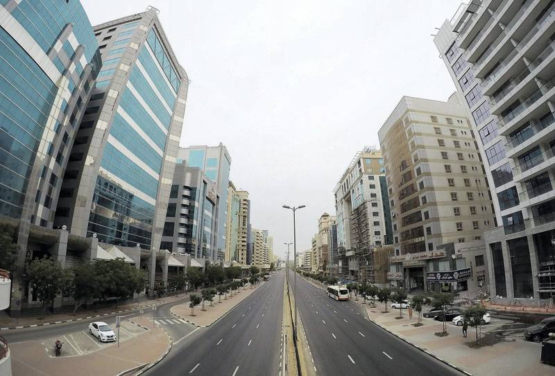 DUBAI, UNITED ARAB EMIRATES , April 11 – 2020 :-  View of the almost empty Al Maktoum road near Deira Clock tower in Deira Dubai. Dubai is conducting 24 hours sterilisation programme across all areas and communities in the Emirate and told residents to stay at home. UAE government told residents to wear face mask and gloves all the times outside the home whether they are showing symptoms of Covid-19 or not. (Pawan Singh/The National) For News/Online/Instagram/Standalone