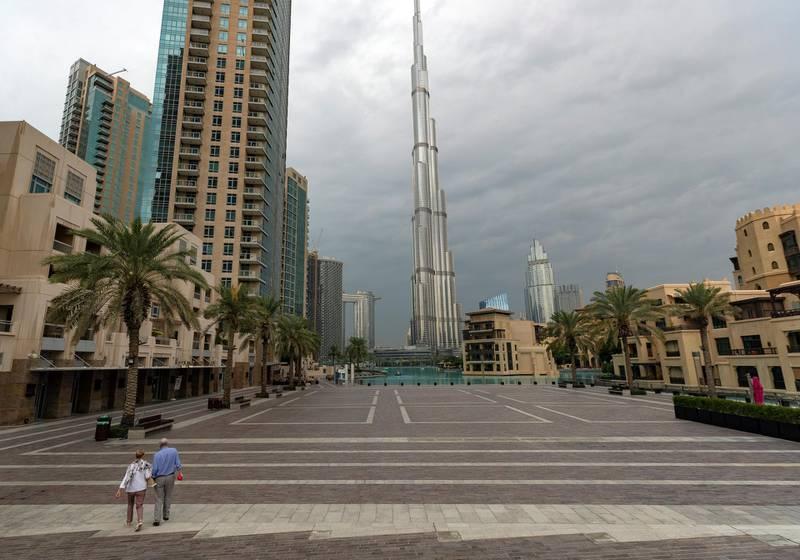 Dubai, United Arab Emirates - Reporter: N/A. Standalone. Dark clouds and rain surround the Burj Khalifa. Tuesday, December 10th, 2019. Downtown, Dubai. Chris Whiteoak / The National