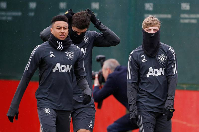 Soccer Football - Europa League - Manchester United Training - Aon Training Complex, Manchester, Britain - February 19, 2020   Manchester United's Jesse Lingard, Brandon Williams and Harry Maguire during training   Action Images via Reuters/Craig Brough