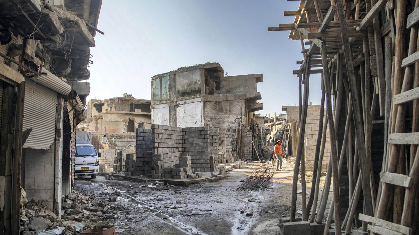 Reconstruction amidst carnage in the old city of Mosul. Haider Husseini/ The National