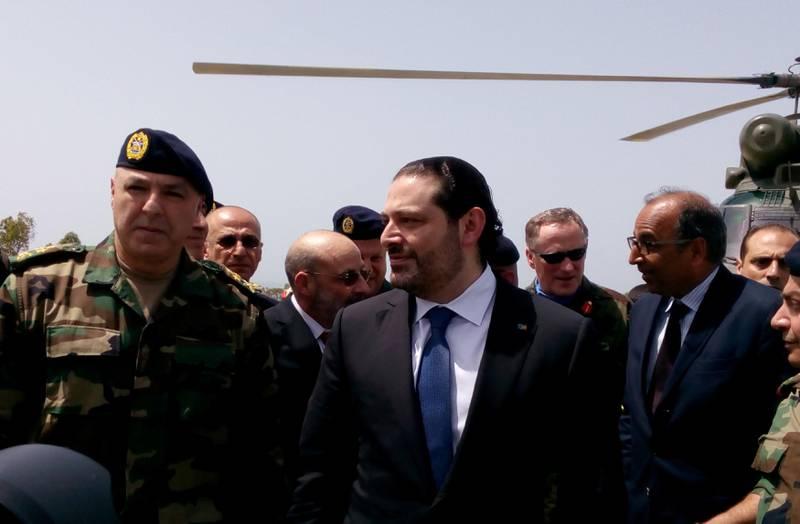 FILE PHOTO: Lebanese Prime Minister Saad al-Hariri arrives with Army Commander General Joseph Aoun (L) at the United Nations Interim Force in Lebanon (UNIFIL) headquarters in Naqoura, near the Lebanese-Israeli border, southern Lebanon April 21, 2017. REUTERS/Ali Hashisho/File Photo