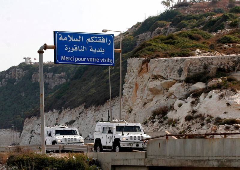 UN military vehicles of the United Nations Interim Forces in Lebanon (UNIFIL) enter the southern Lebanese border town of Naqura where the second round of of talks started on October 28, 2020 between Lebanon and Israel at a UN base on the demarcation of the maritime frontier between the two countries. Lebanon and Israel, still technically at war and with no diplomatic ties, launched a second round of maritime border talks Wednesday under UN and US auspices to allow for offshore energy exploration. / AFP / Mahmoud ZAYYAT