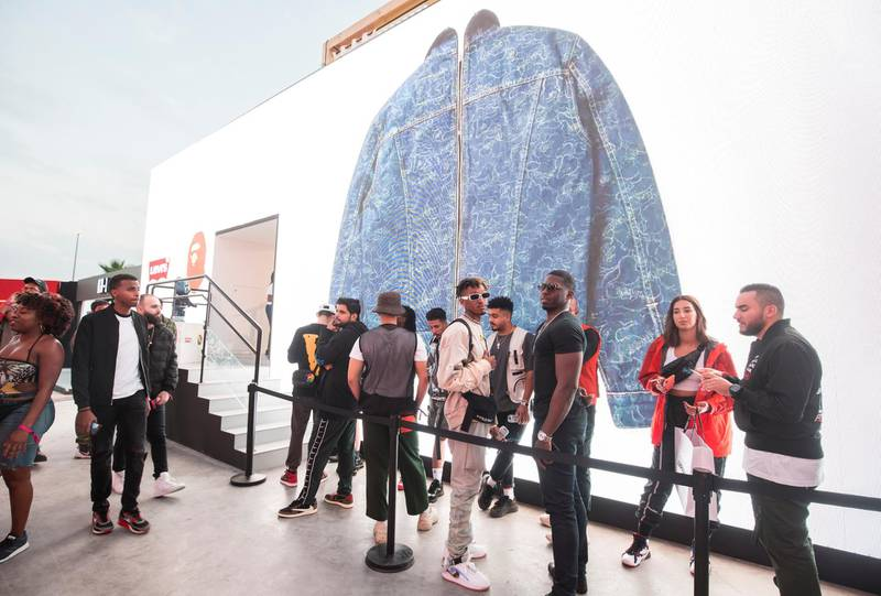 Dubai, United Arab Emirates-  Visitors waiting in queue for entertainment inside a brand house at the Sole Dubai Festival at D3.  Leslie Pableo for The National for Saeed Saeed's story