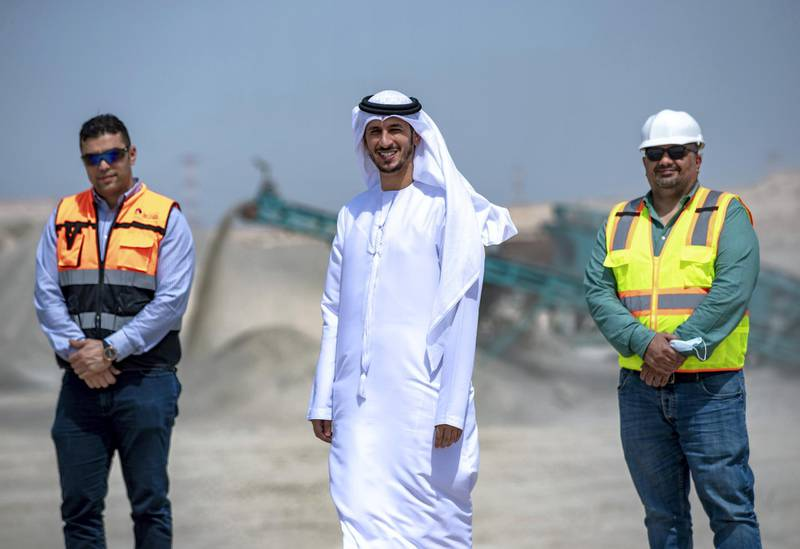 Abu Dhabi, United Arab Emirates, March 10, 2021.  A tour of the Ghayathi waste crusher facility in Al Dhafra region.  (L-R). Mohannad Raouf, Plant Manager, Al Dhafra Recycling Indstries; Khalid Al Khanbashi, Tadweer Ghayathi; Ahmed Nour Gamil, Operations director, EIS.Victor Besa/The NationalSection:  NAReporter:  Haneen Dajani