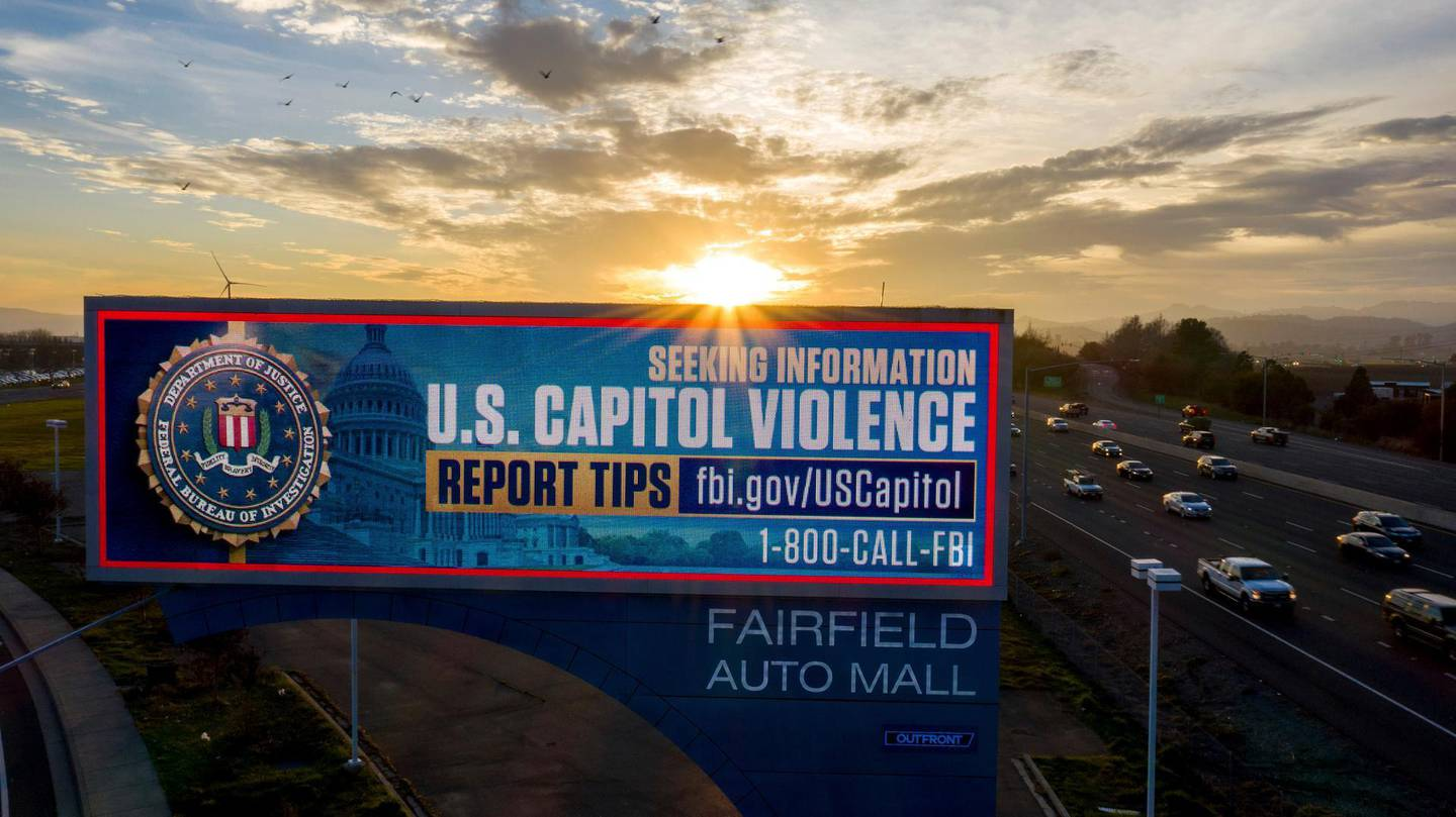 """In a photo taken with a drone, a billboard seeking tips about """"Stop The Steal"""" protesters who breached the United States Capitol Building stands in Fairfield, Calif., on Friday, Jan. 15, 2021. (AP Photo/Noah Berger)"""