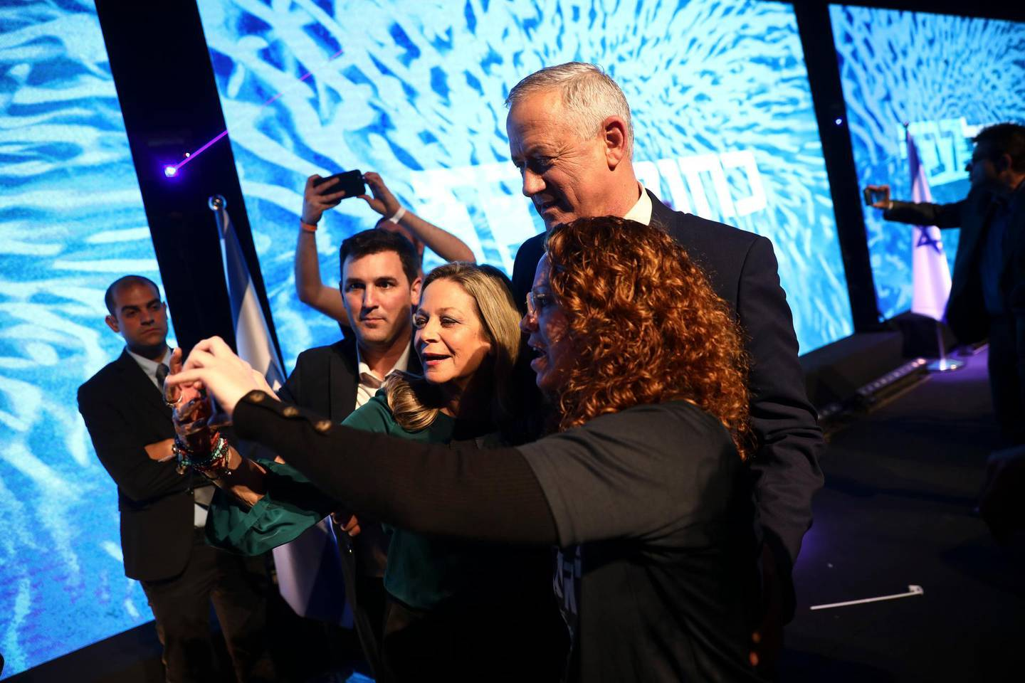 Blue and White party leader Benny Gantz with supporters during election campaign rally in Tel Aviv, Israel, Saturday, Feb. 29, 2020. (AP Photo/Oded Balilty)