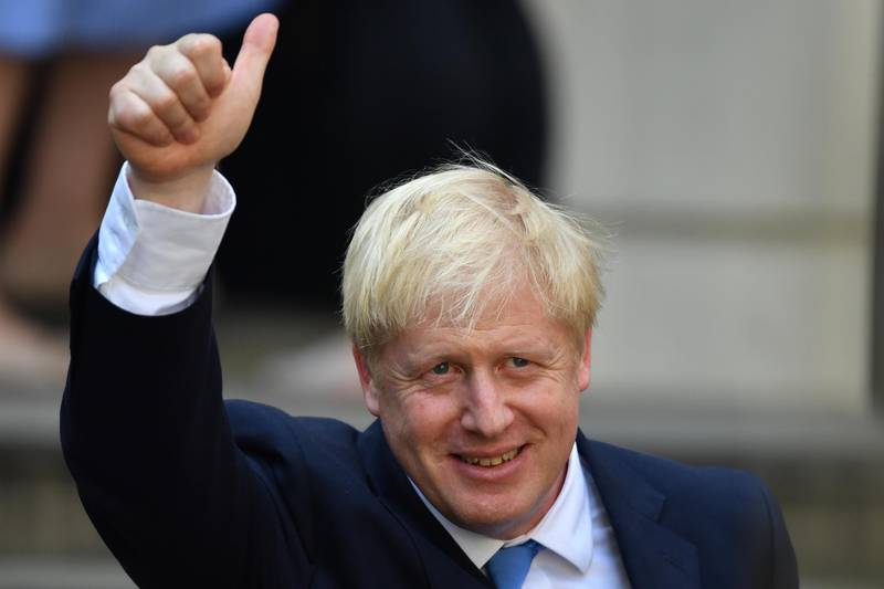LONDON, ENGLAND - JULY 23: Newly elected leader of the Conservative party Boris Johnson gestures at Conservative party HQ in Westminster on July 23, 2019 in London, England. After a month of hustings, campaigning and televised debates the members of the UK's Conservative and Unionist Party have voted for Boris Johnson to be their new leader and the country's next Prime Minister, replacing Theresa May. (Photo by Jeff J Mitchell/Getty Images)