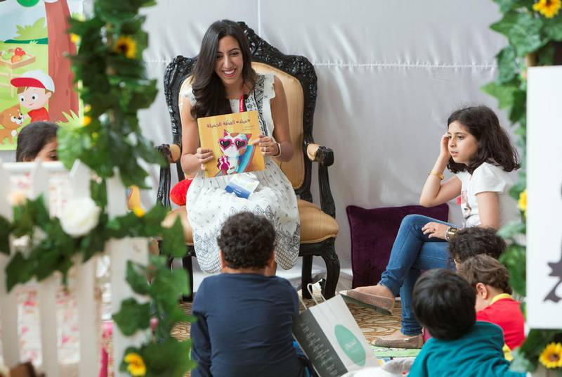 DUBAI, UNITED ARAB EMIRATES - Author Dina Elabd reading her book to kids at the Literature Festival, Dubai Festival City.  Leslie Pableo for the National