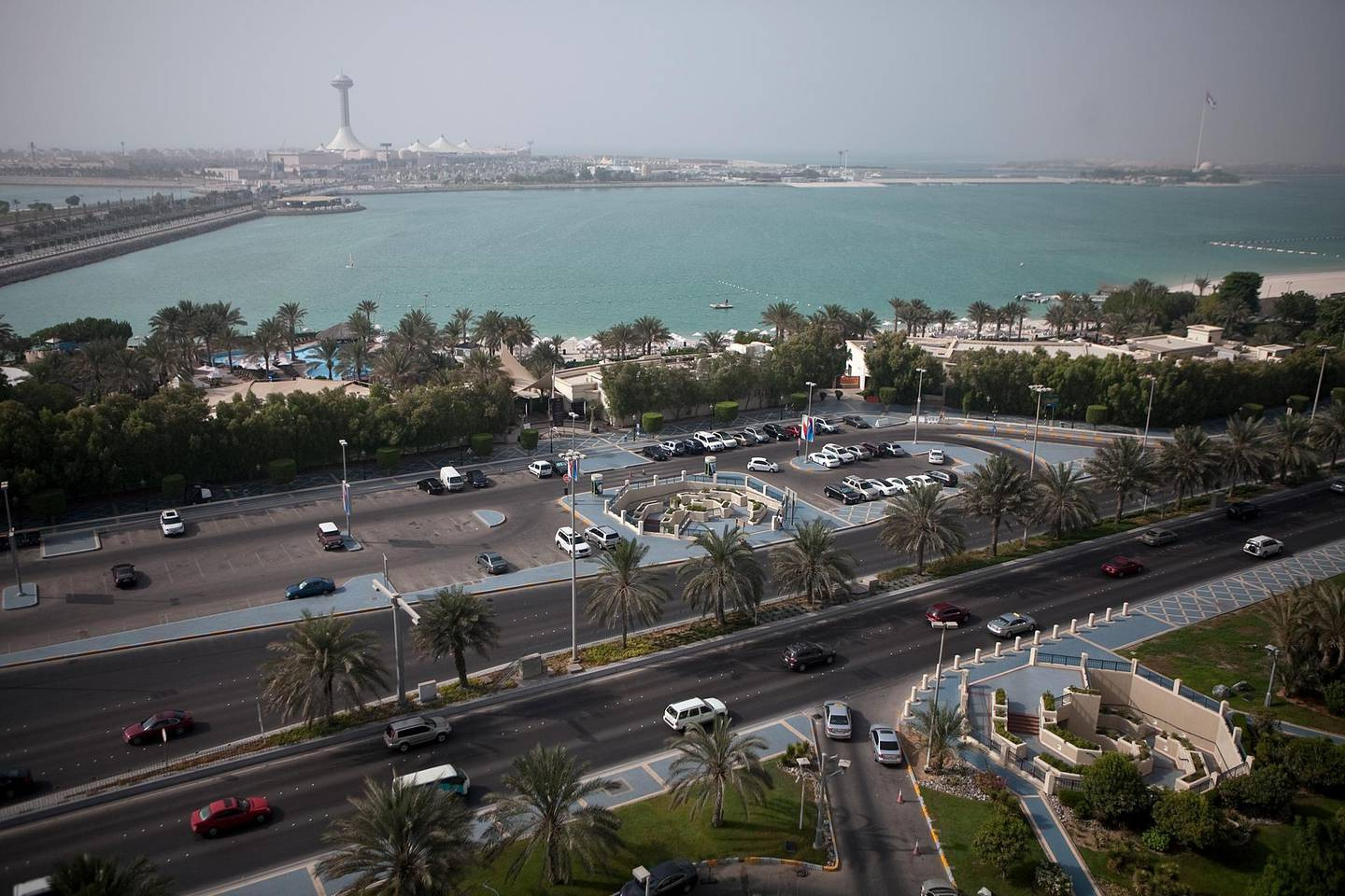 Abu Dhabi, United Arab Emirates, August 16, 2012:   View of the Corniche Road, the Hiltonia Beach Club and the Marina Mall in then background, as seen from the Hilton Abu Dhabi hotel on Thursday, August 15, 2012, at the hotel's Corniche Road location in Abu Dhabi. (Silvia Razgova / The National)