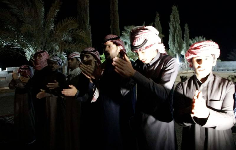 The Al Faqeer Tribe engage in an evening dance to farewell their visitors. Suhail Rather/TheNational