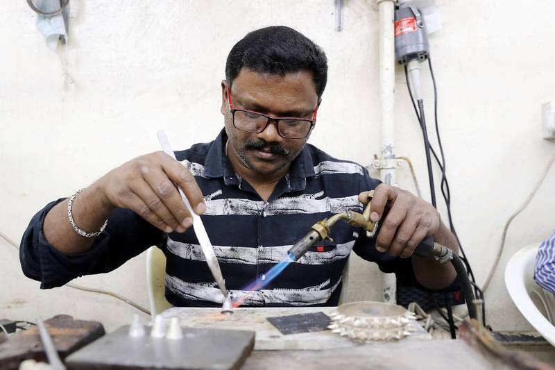 SHARJAH , UNITED ARAB EMIRATES , OCT 24   – 2017 :- Surenderan K from Kerala , India making silver jewellery at the Al Baroon silver shop in the Al Mareija area near the Heritage area in Sharjah. He is working in this shop for the last 15 years. (Pawan Singh / The National) For Weekend