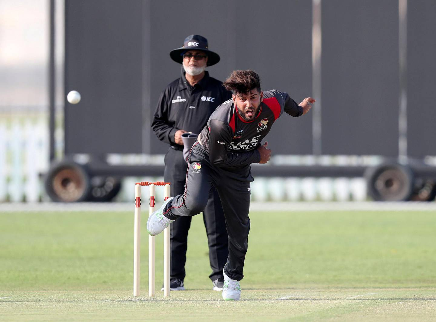 Abu Dhabi, United Arab Emirates - October 22, 2018: Mohammad Naveed of the UAE bowls in the match between the UAE and Australia in a T20 international. Monday, October 22nd, 2018 at Zayed cricket stadium oval, Abu Dhabi. Chris Whiteoak / The National