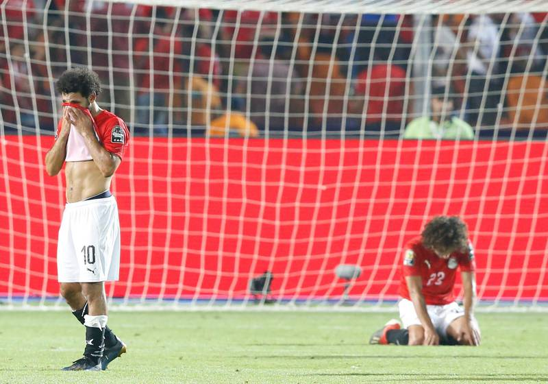 Egypt's Mohamed Salah, left, and Amp Warda react after the African Cup of Nations round of 16 soccer match between Egypt and South Africa in Cairo International stadium in Cairo, Egypt, Saturday, July 6, 2019. (AP Photo/Ariel Schalit)