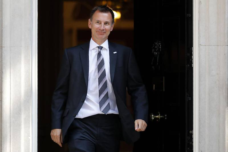 (FILES) In this file photo taken on July 3, 2018 Britain's Health and Social Care Secretary Jeremy Hunt leaves 10 Downing Street in central London after attending the weekly cabinet meeting.  Jeremy Hunt has been named as Britain's Foreign secretary on July 9, 2018 following the resignation of Boris Johnson. / AFP / Tolga AKMEN