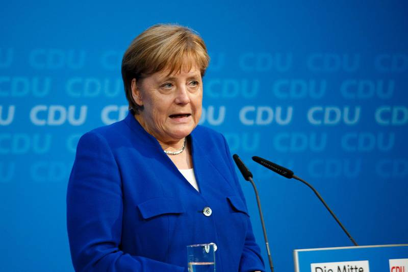 BERLIN, GERMANY - JULY 02:  German Chancellor and leader of the German Chistian Democrats (CDU) Angela Merkel speaks to the media after a meeting with Horst Seehofer, German Interior Minister and leader of the Bavarian Social Union (CSU) at CDU party headquarters on July 2, 2018 in Berlin, Germany. Seehofer had announced he will resign yesterday from both posts over what he sees as insufficient policy by Merkel over asylum and migraiton policy. He then announced he will postpone his resignation in order to meet with Merkel later today.  (Photo by Carsten Koall/Getty Images)