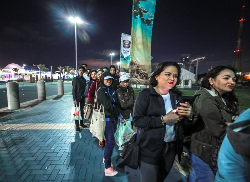 Abu Dhabi, U.A.E., February 5, 2019.   Worshipers heading onto buses at Nation Towers before they're transported to the mass.Victor Besa/The NationalSection:  NAReporter: